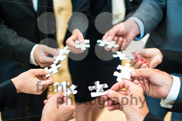 Teamwork – Business people solving a puzzle - franky242 photography