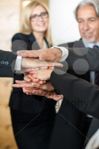 Teamwork – business people with joint hands in the office - franky242 photography