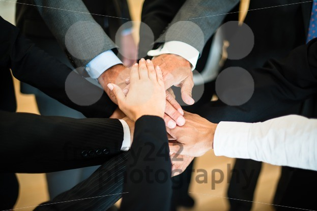Teamwork – stack of hands - franky242 photography