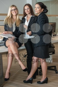 Three Businesswomen In Office Working On A Document - franky242 photography