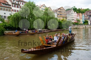 Traditional punt in front of the waterfront of Tubingen aka Tuebingen, Germany - franky242 photography