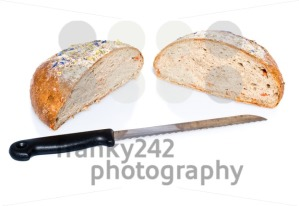 Two half loafs of bread with knife - franky242 photography