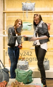 Two young girls shopping for handbags - franky242 photography