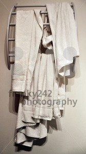 Used-hotel-towels-on-modern-rack