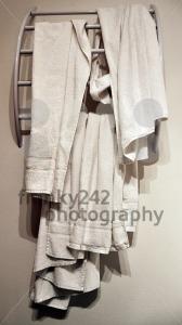 Used-hotel-towels-on-modern-rack