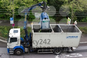 Van-emptying-glass-recycling-container