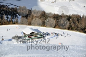 View-down-ski-slope-on-chairlift-station