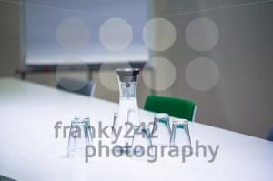 Water bottle and glasses in meeting room - franky242 photography