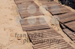 Weathered wooden boardwalk on sand - franky242 photography
