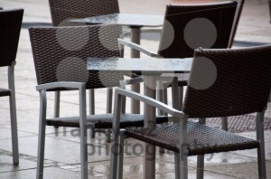 Wet-Chairs-And-Tables-Outside-Cafe