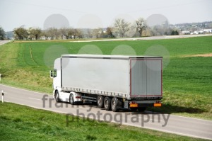 White truck moving on a main road - franky242 photography