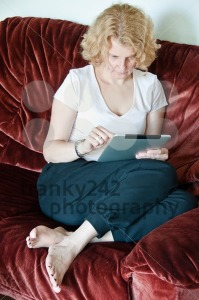 Woman browsing a touchscreen table - franky242 photography
