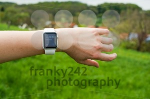 Woman checking her Apple Watch in the green - franky242 photography