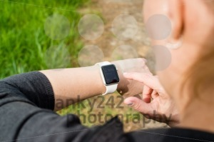 Woman checking her Apple Watch while walking - franky242 photography