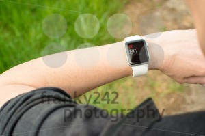Woman checking her pulse using the Apple Watch - franky242 photography
