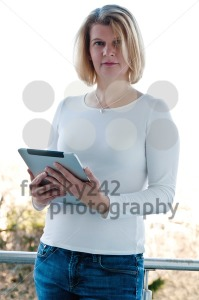 Woman holding a touchscreen table - franky242 photography