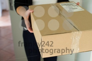 Woman receiving parcel - franky242 photography