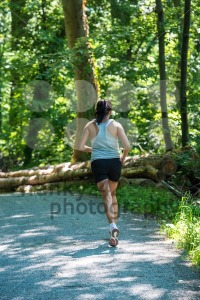Woman running in the forest - franky242 photography