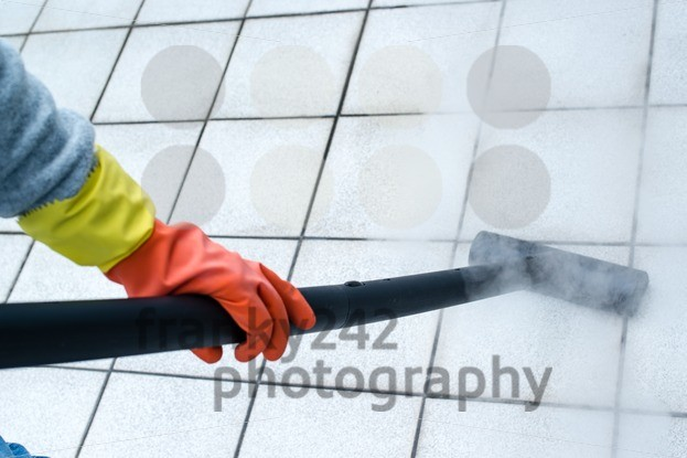 Woman using steam cleaner - franky242 photography