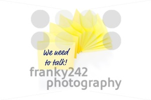 Yellow sticky note on block with message We Need To Talk - franky242 photography