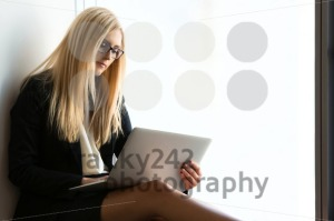 Young pretty business woman with a laptop - franky242 photography