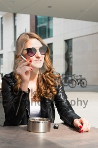 Young woman smoking a cigarette - franky242 photography