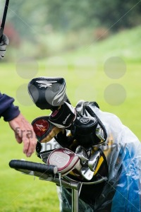 golf-club-set-in-carrier-bag-during-rain