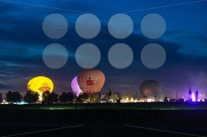 hot-air-ballons-and-tents-in-the-evening-during-a-festival