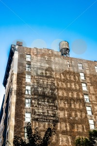 old urban building with list of former brands in new york - franky242 photography