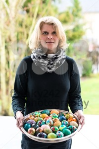 woman presenting easter eggs - franky242 photography