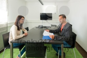 Smiling young female candidate during job interview - franky242 photography