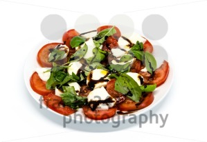Tomato and mozzarella with basil leaves on a plate - franky242 photography
