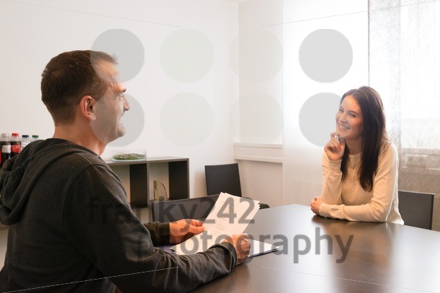 Young female candidate smiling very relaxed during job interview - franky242 photography
