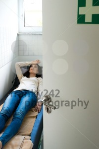 Young woman is relaxing in a quiet room of an office - franky242 photography