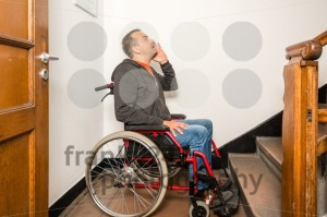 man in wheelchair facing a barrier of stairs - franky242 photography