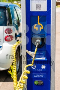 A car-sharing electric Smart is being recharged - franky242 photography