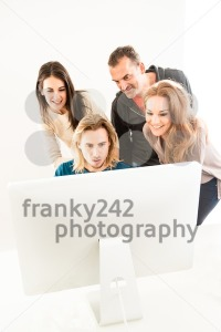 Abstract: Business team in office looking at computer monitor - franky242 photography