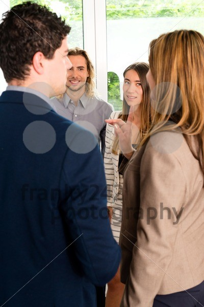 Businesspeople discussing in office - franky242 photography