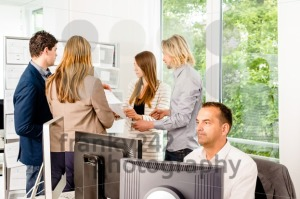 Businesspeople working in office - franky242 photography