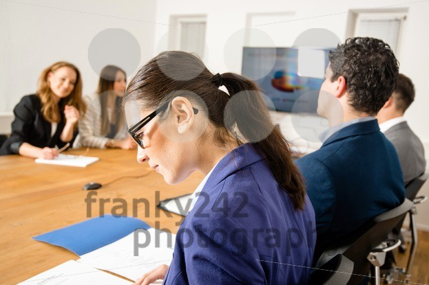 Checking facts during business meeting - franky242 photography