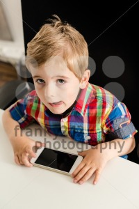 Little boy plays with smartphone - franky242 photography