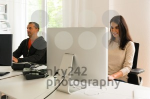 Office people being absorbed in their work - franky242 photography