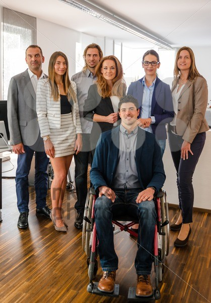 Portrait Of Business Team With Wheelchair - franky242 photography