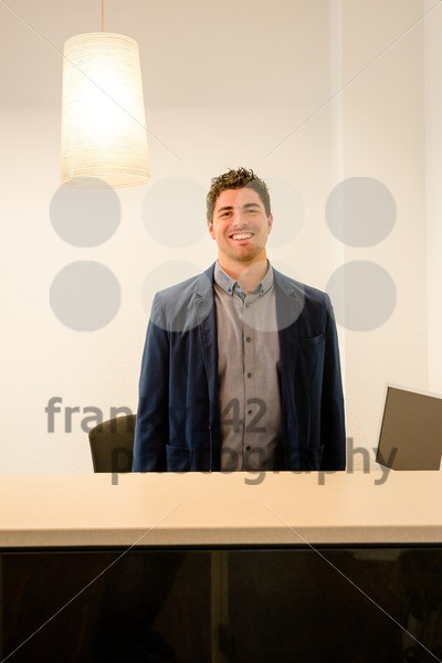 Young receptionist smiling - franky242 photography