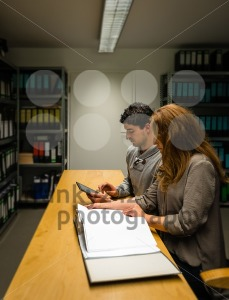 digitalization: young man and woman in the company archives - franky242 photography