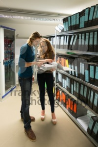 young man and woman in the company archives with servers - franky242 photography