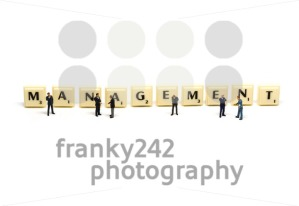 Management – Letters being surrounded by miniature figures - franky242 photography