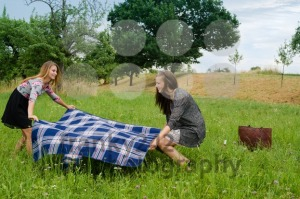 Two girls  spreading a blanket for picnic - franky242 photography