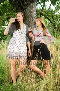 Two pretty girls in the garden under a tree - franky242 photography