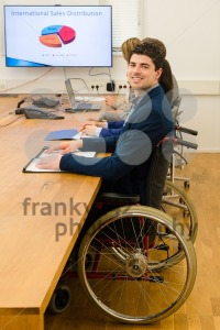 man in wheelchair during business meeting - franky242 photography